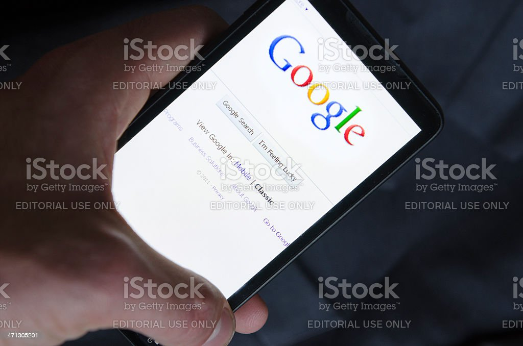 hand holding Smart phone with Google stock photo