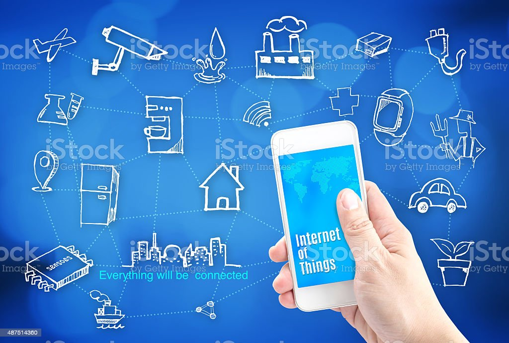 Hand holding smart phone with Internet of things (IoT) stock photo