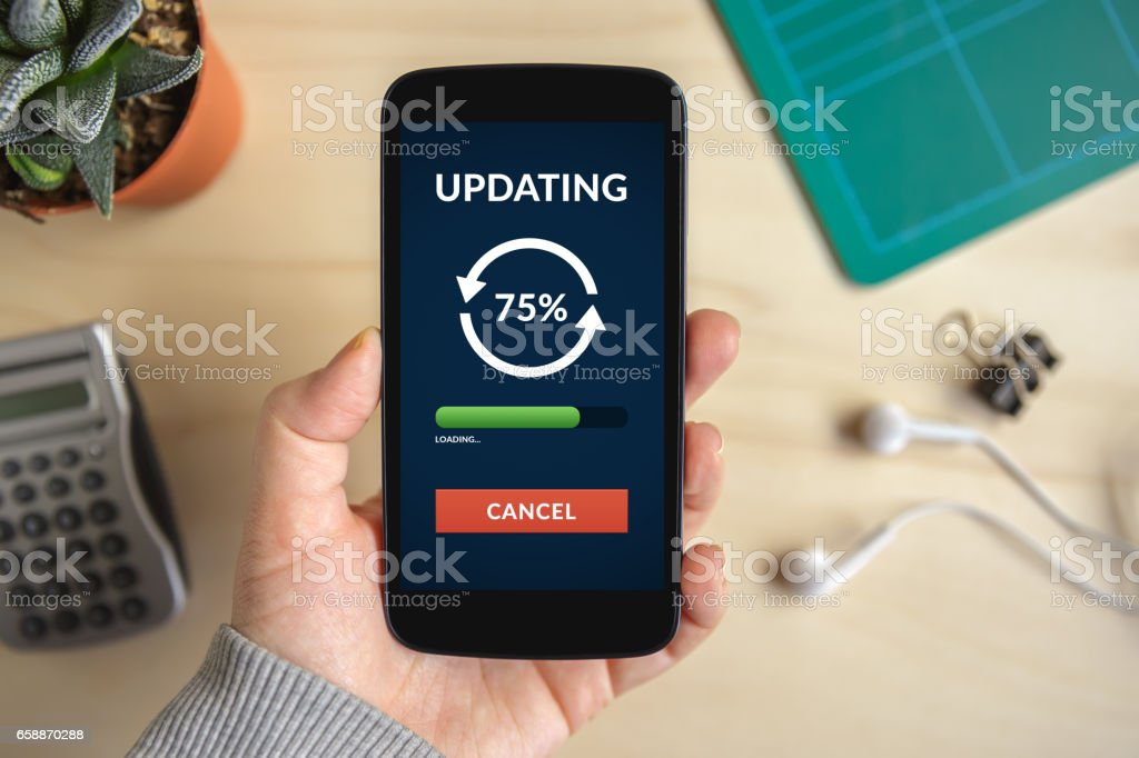 Hand holding smart phone with update concept on screen stock photo