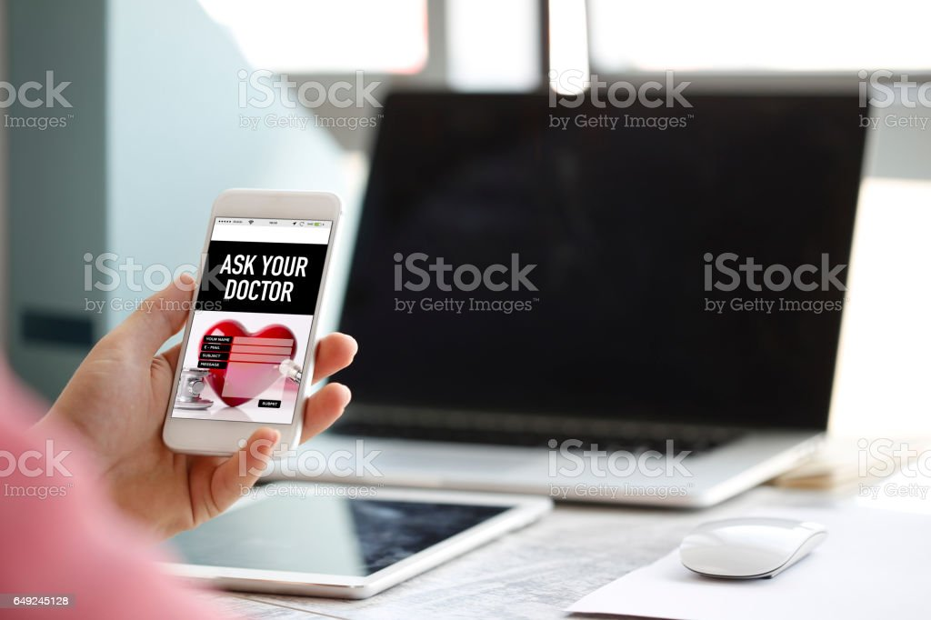 Hand Holding Smartphone and Showing Ask Your Doctor App stock photo