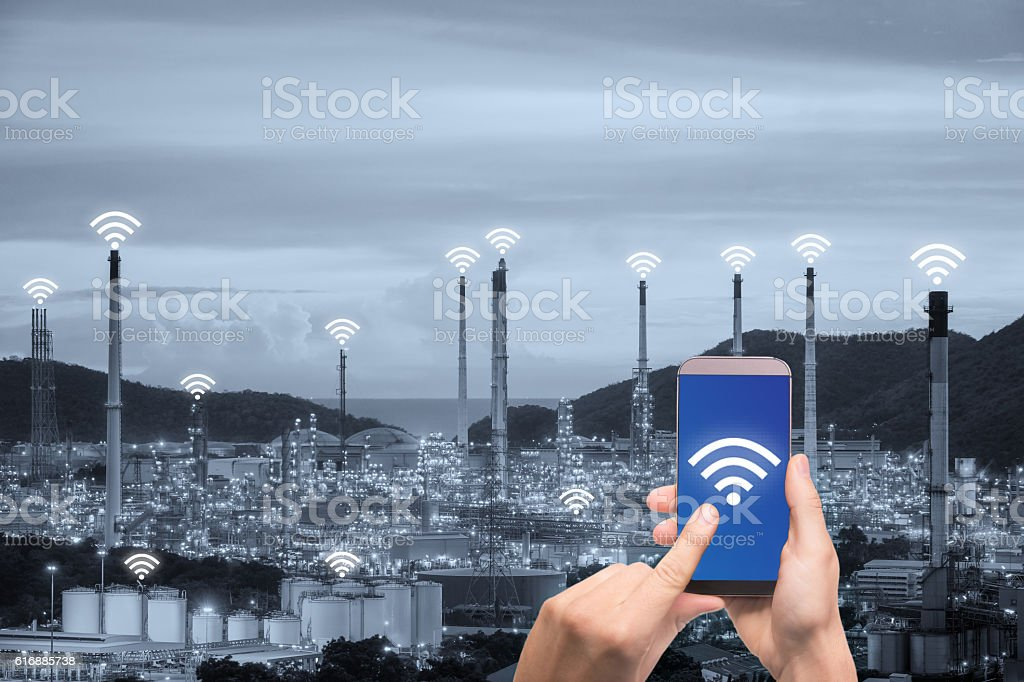 Hand holding smartphone control wireless communication network stock photo
