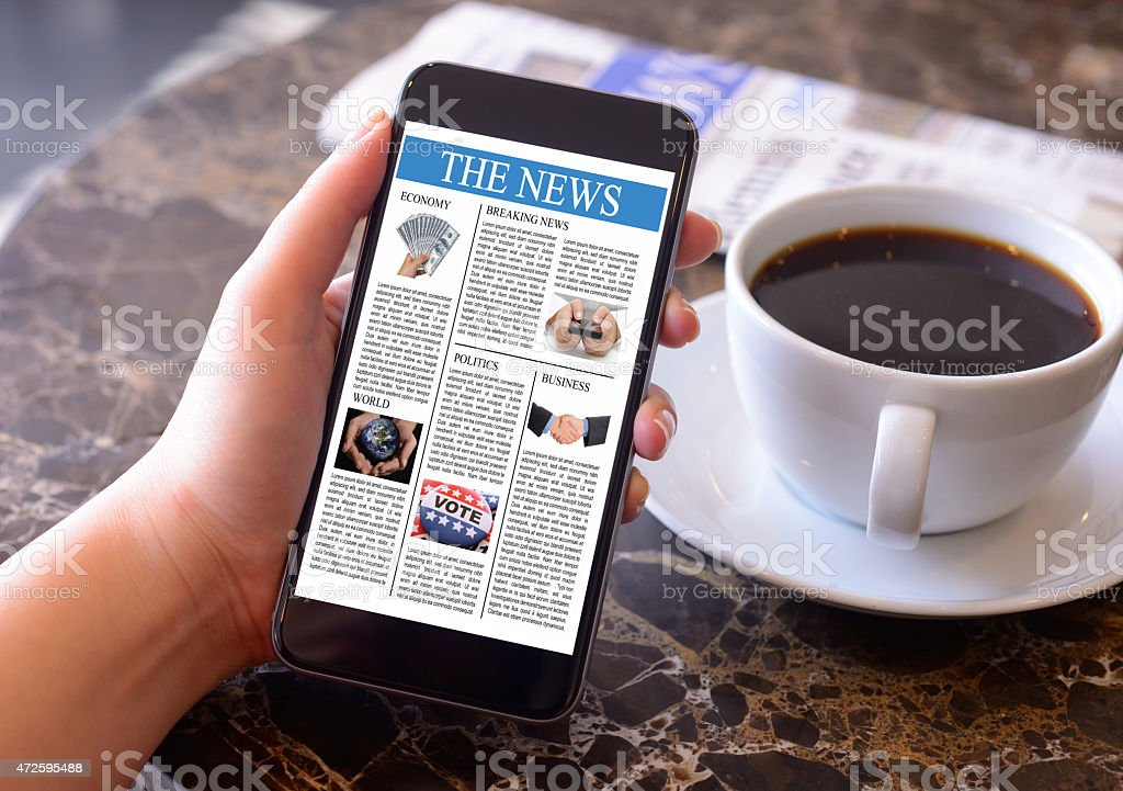 Hand holding smartphone displaying news stock photo