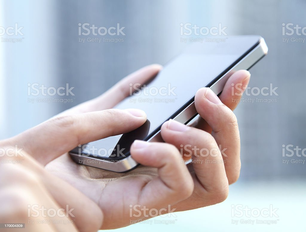 Hand holding smartphone stock photo