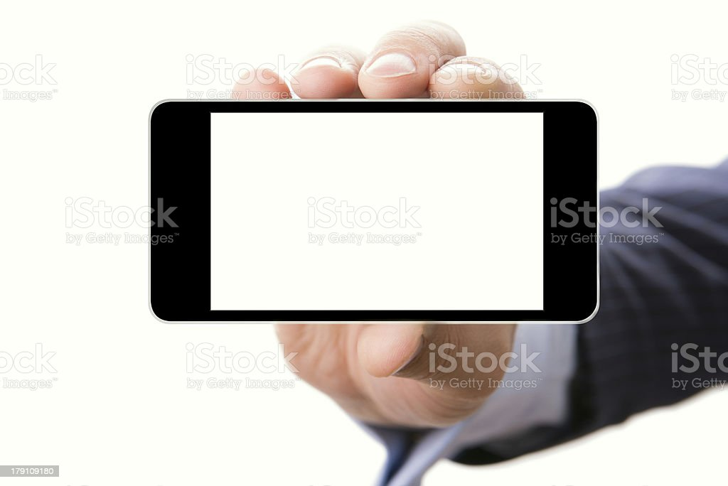 Hand holding smartphone with a blank screen royalty-free stock photo
