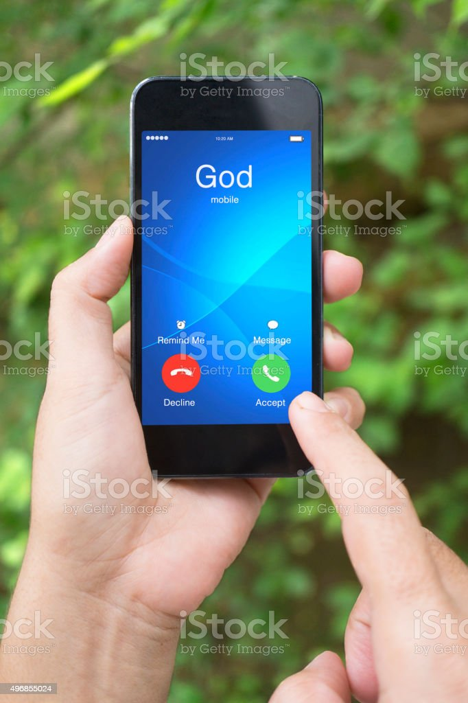 Hand Holding Smartphone with GOD Incoming Calls stock photo
