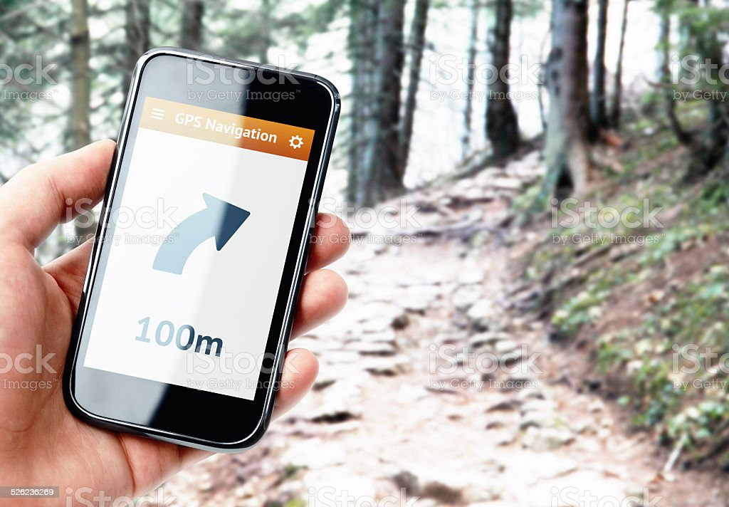 Hand holding smartphone with gps navigation stock photo