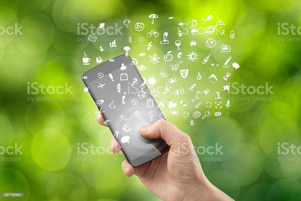 Hand holding smartphone with icons stock photo