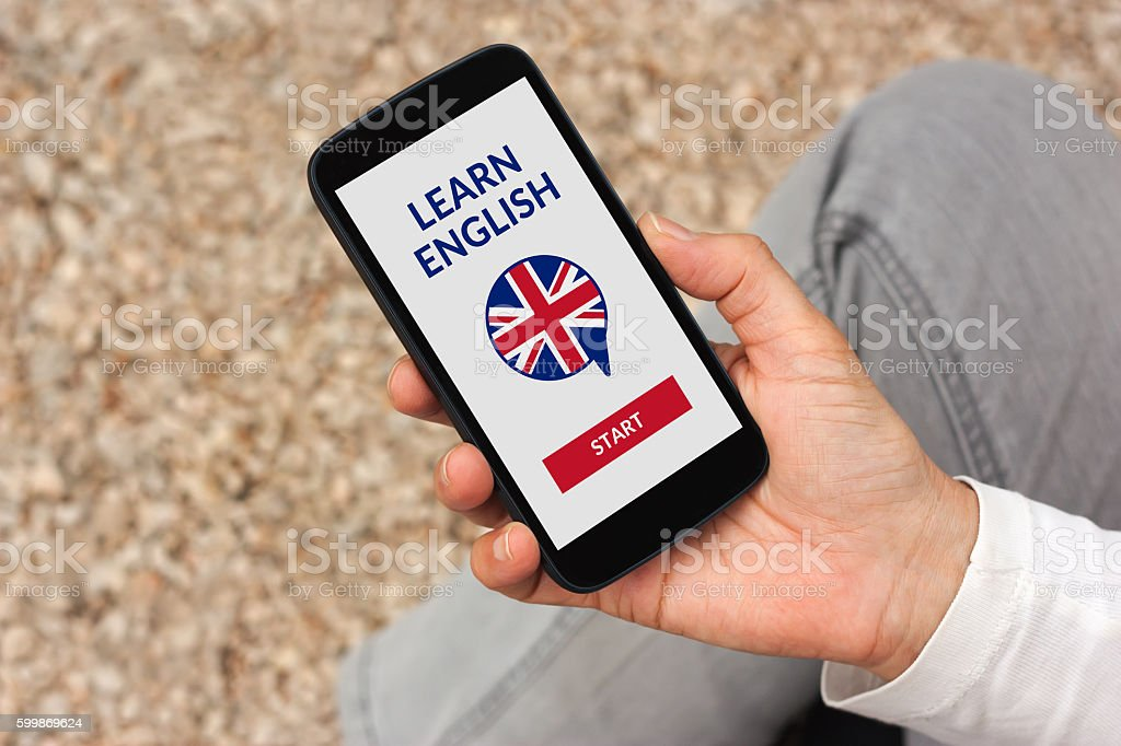Hand holding smartphone with online learn English concept on screen stock photo