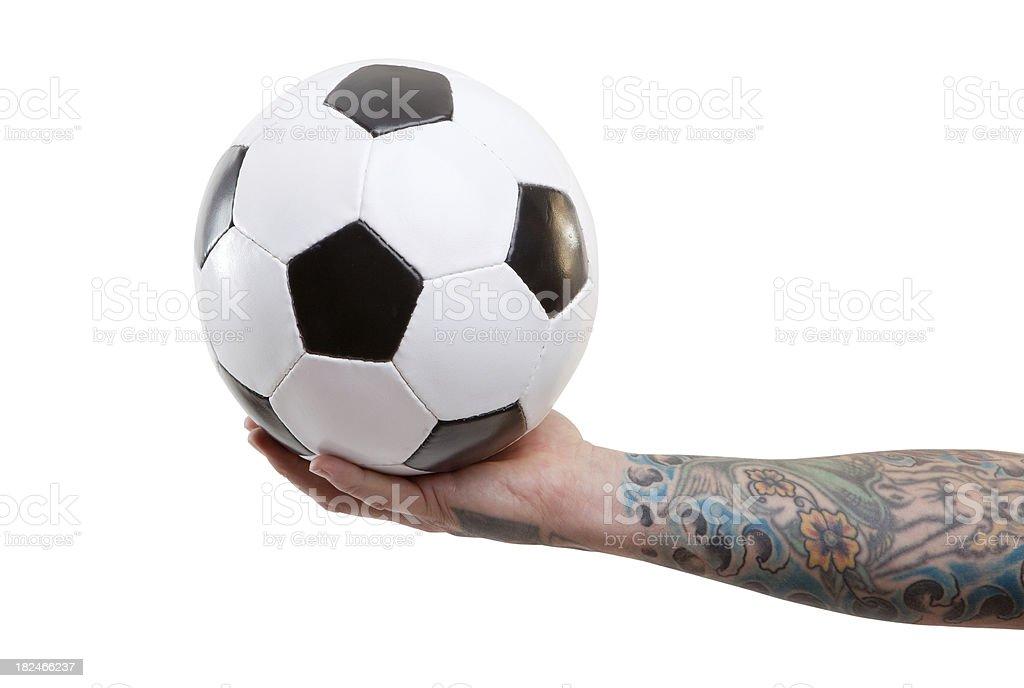 Hand holding soccer ball stock photo