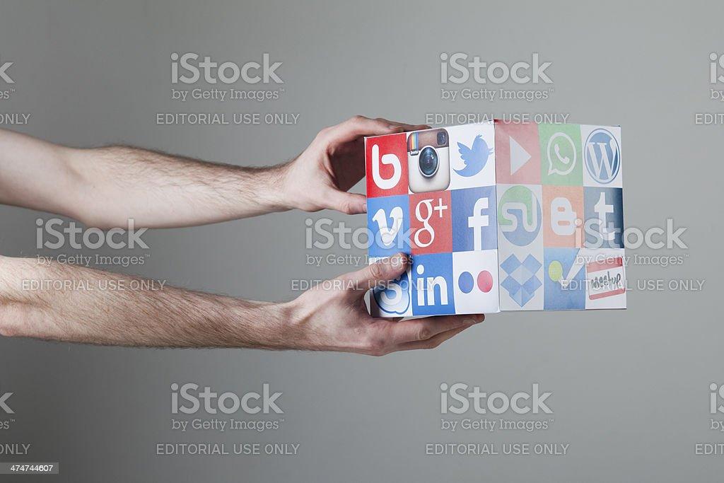 Hand holding social media cube stock photo
