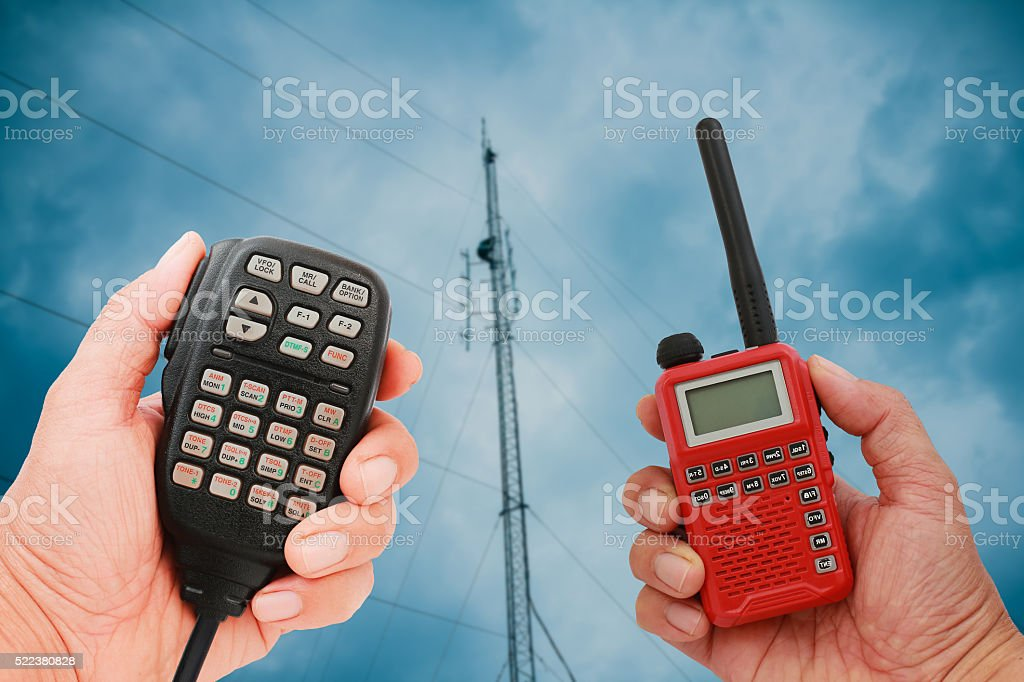 Hand holding speaker microphone stock photo