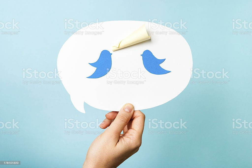 Hand holding speech bubble. Blue birds megaphone. Content marketing concept stock photo