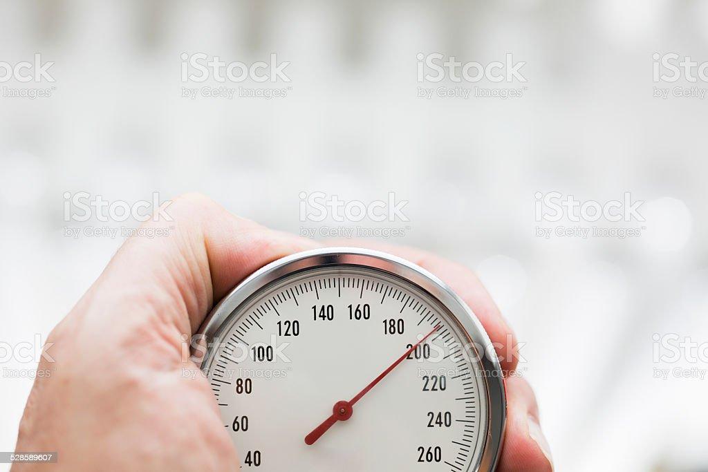 Hand holding Sphygmomanometer close up stock photo