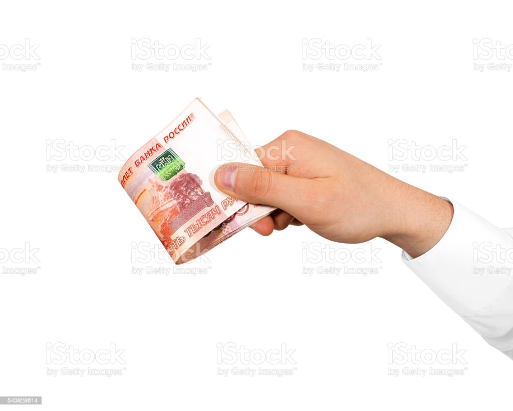 Hand holding stack of russian roubles isolated. Russia money fiv stock photo