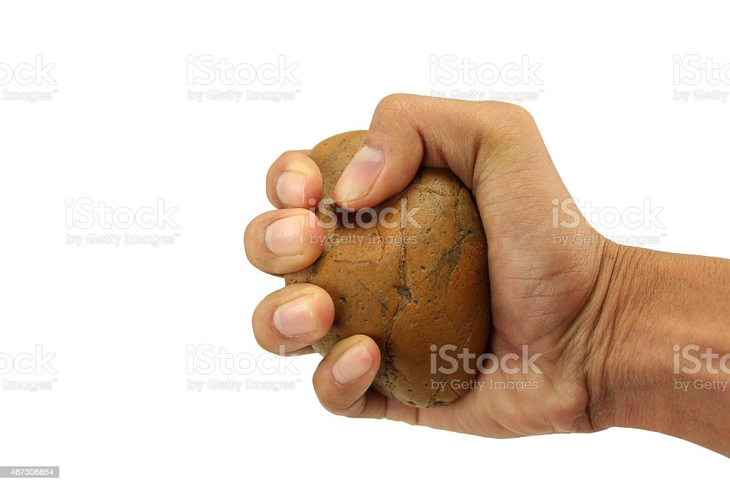 hand holding stone stock photo