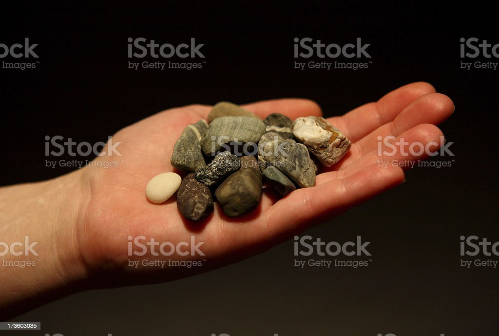 Hand Holding Stones royalty-free stock photo