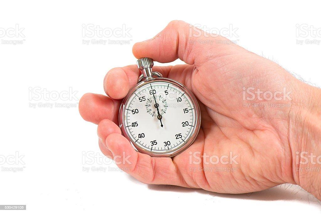 Hand holding stopwatch stock photo