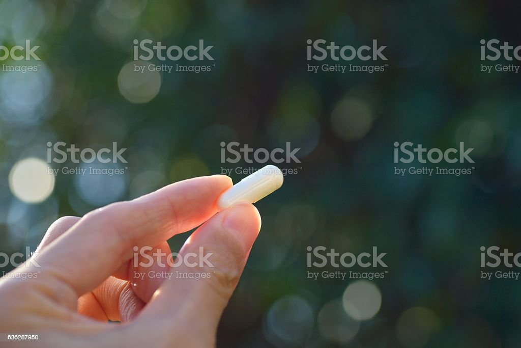 Hand Holding Supplement stock photo