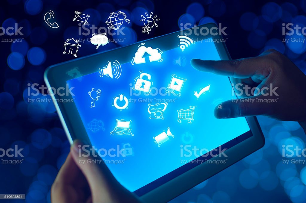 Hand holding tablet device with media application stock photo