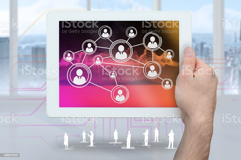 Hand holding tablet pc showing online community links royalty-free stock photo