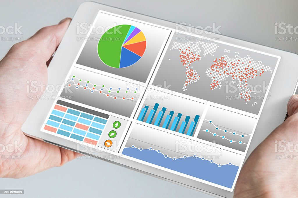 Hand holding tablet with analytics dashboard for sales and marketing stock photo