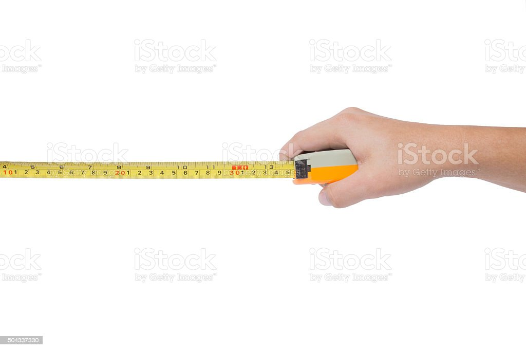Hand holding tape cartridge meter isolated on white stock photo