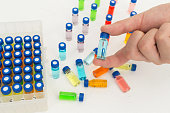 hand holding test tube vaccine in medical laboratory