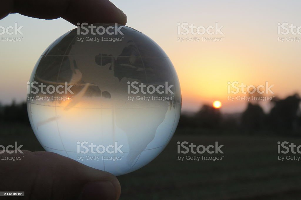 Hand holding the glass ball. stock photo