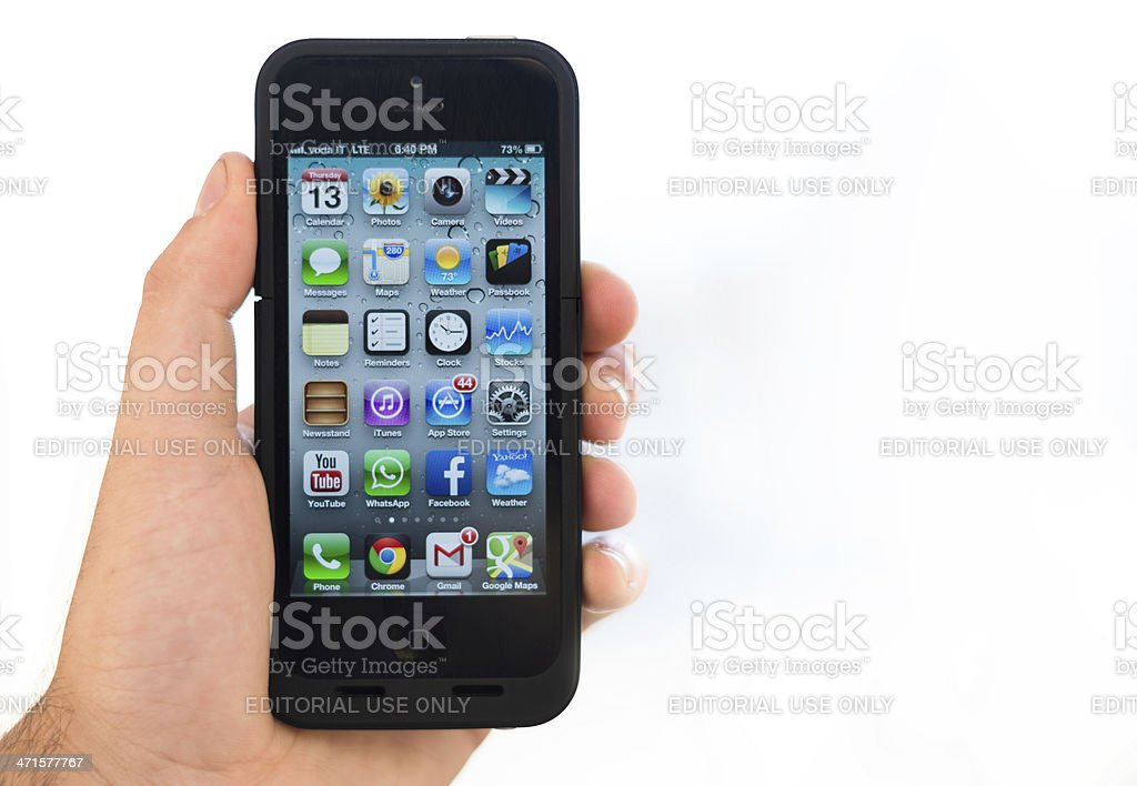 hand holding the Iphone 5 royalty-free stock photo