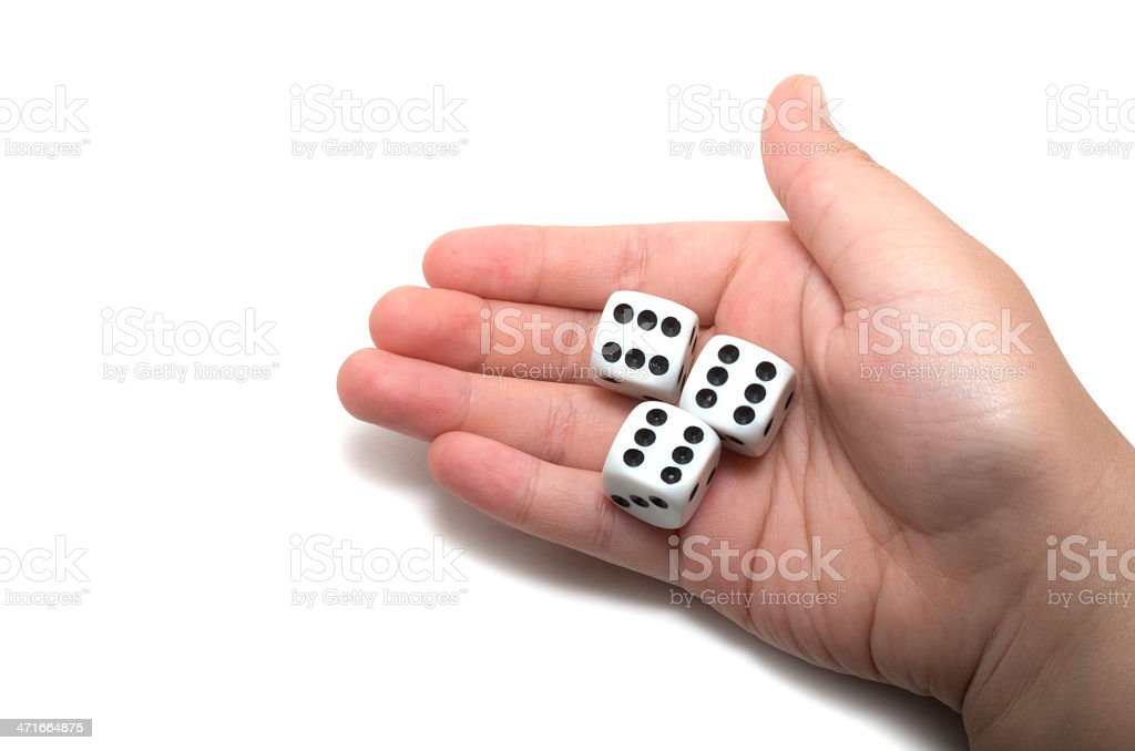 Hand holding three dices royalty-free stock photo