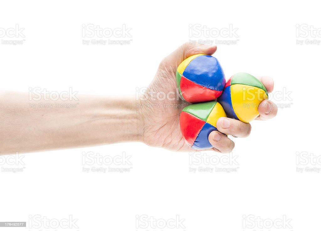 Hand holding three juggling balls royalty-free stock photo