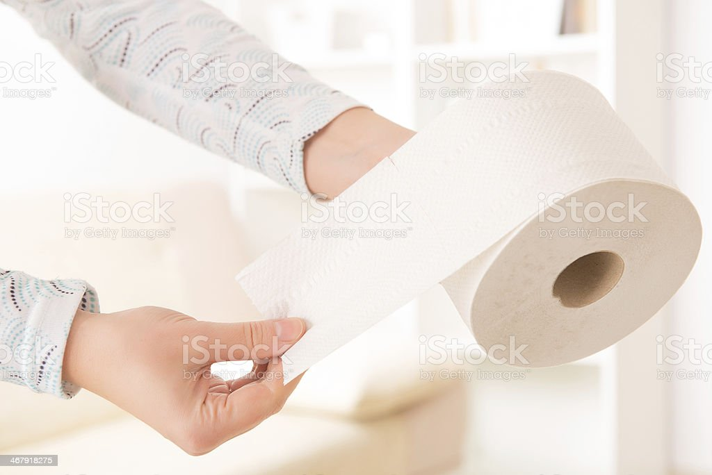 Hand holding toilet paper stock photo