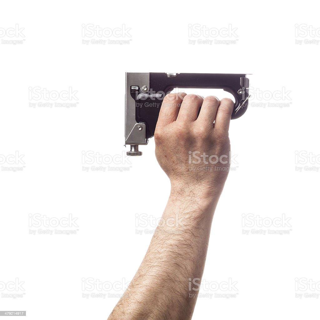 Hand holding tools: Staple Gun stock photo