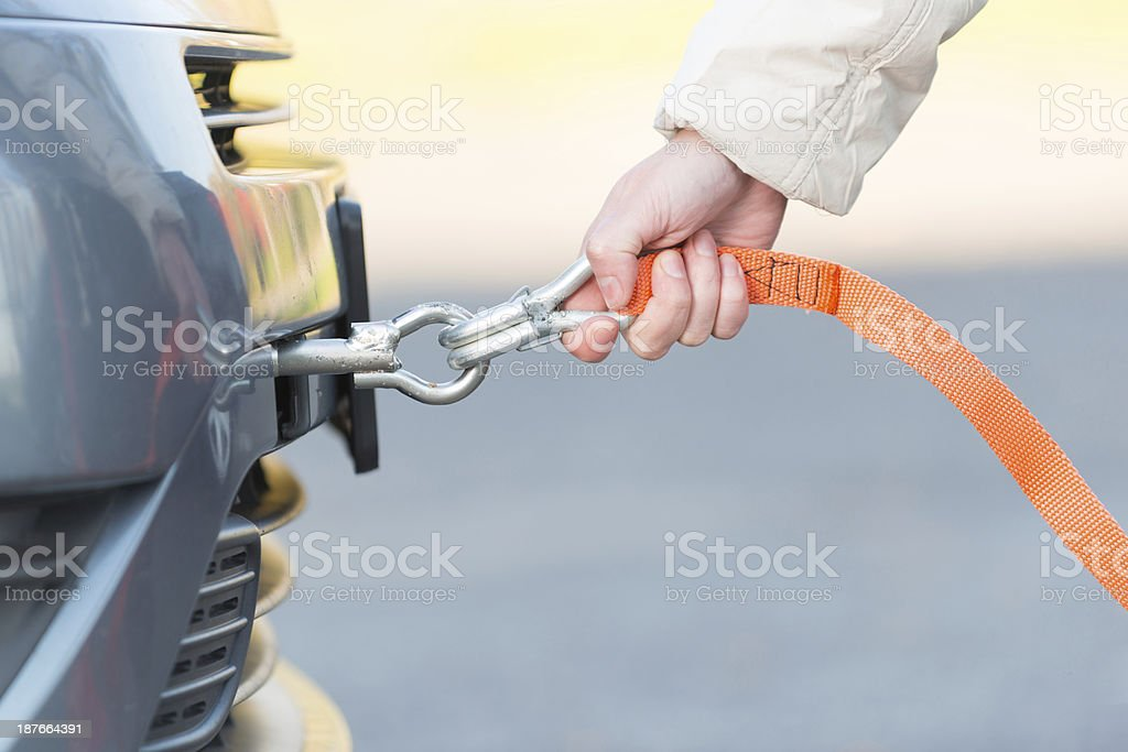 Hand holding tow rope stock photo
