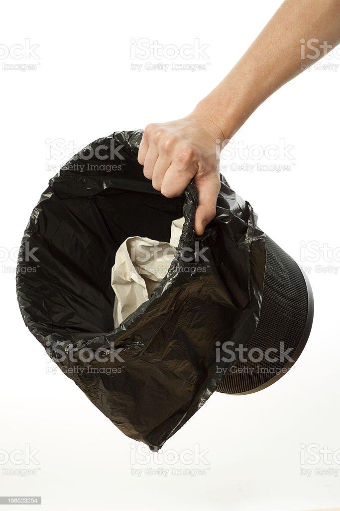 Hand holding trash bin royalty-free stock photo
