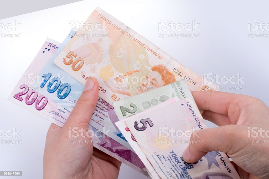 Hand holding Turksh Lira banknotes  in hand stock photo