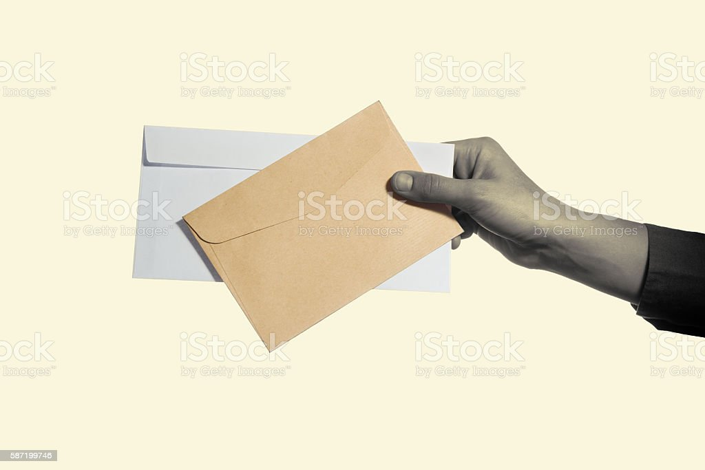 hand holding two envelopes stock photo
