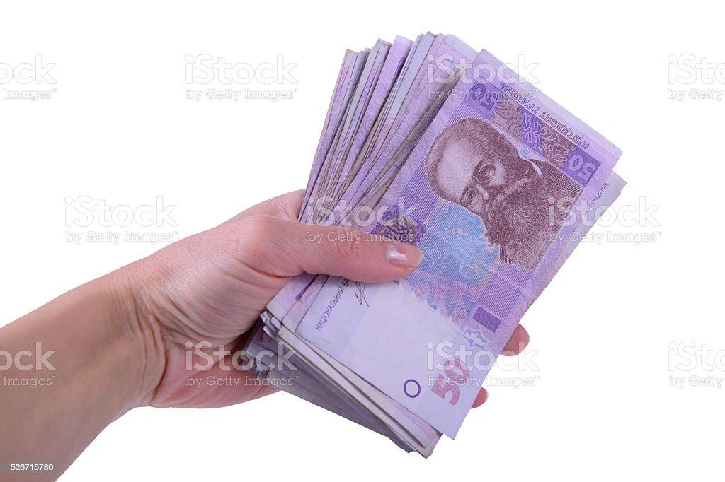 hand holding Ukrainian hryvnia stock photo
