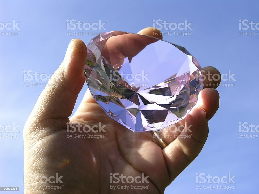 Hand holding up a gem treasure  stock photo