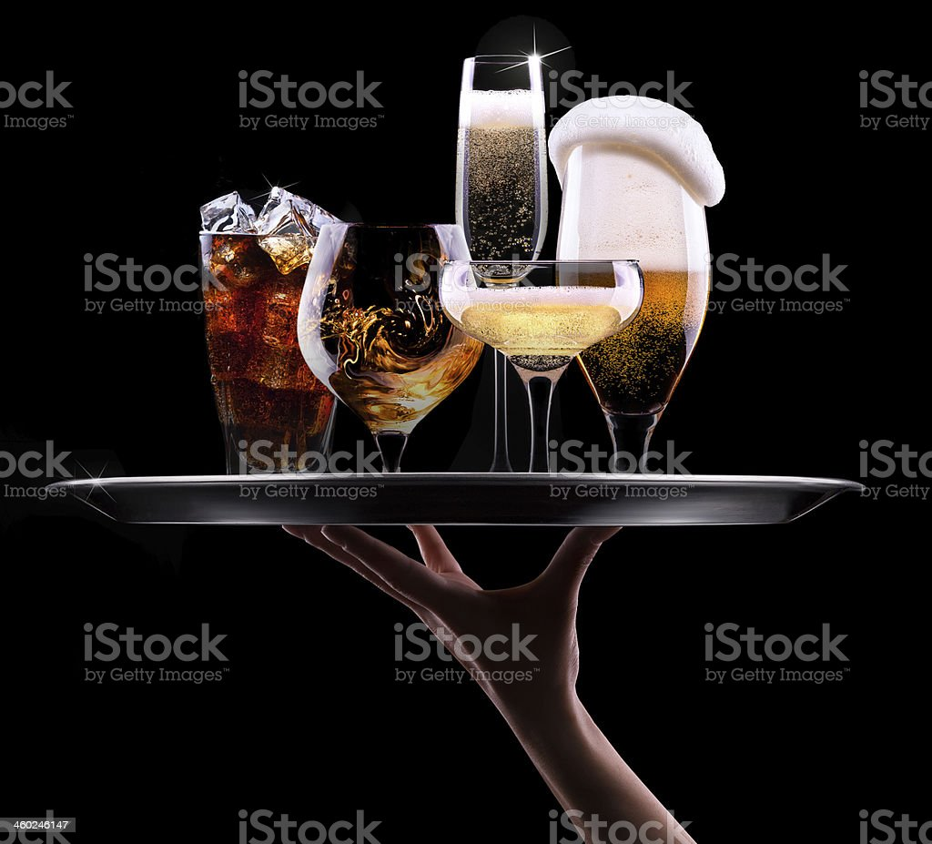Hand holding up a tray with different alcoholic beverages stock photo