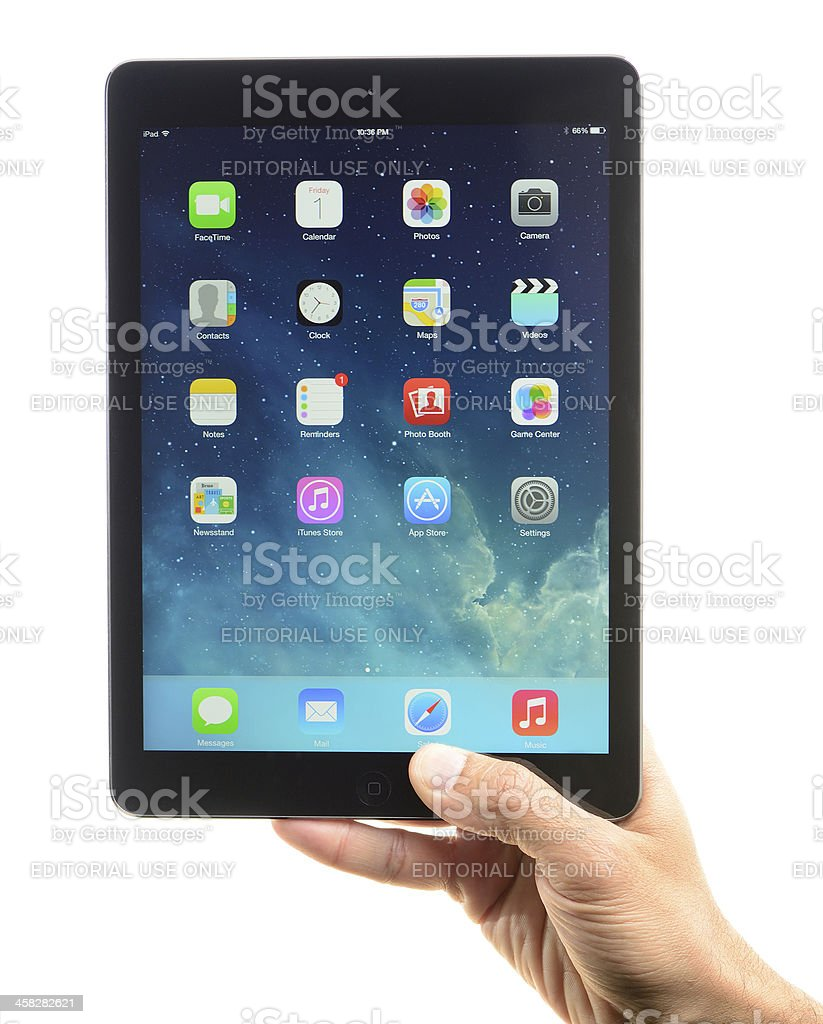 Hand Holding Up iPad Air royalty-free stock photo