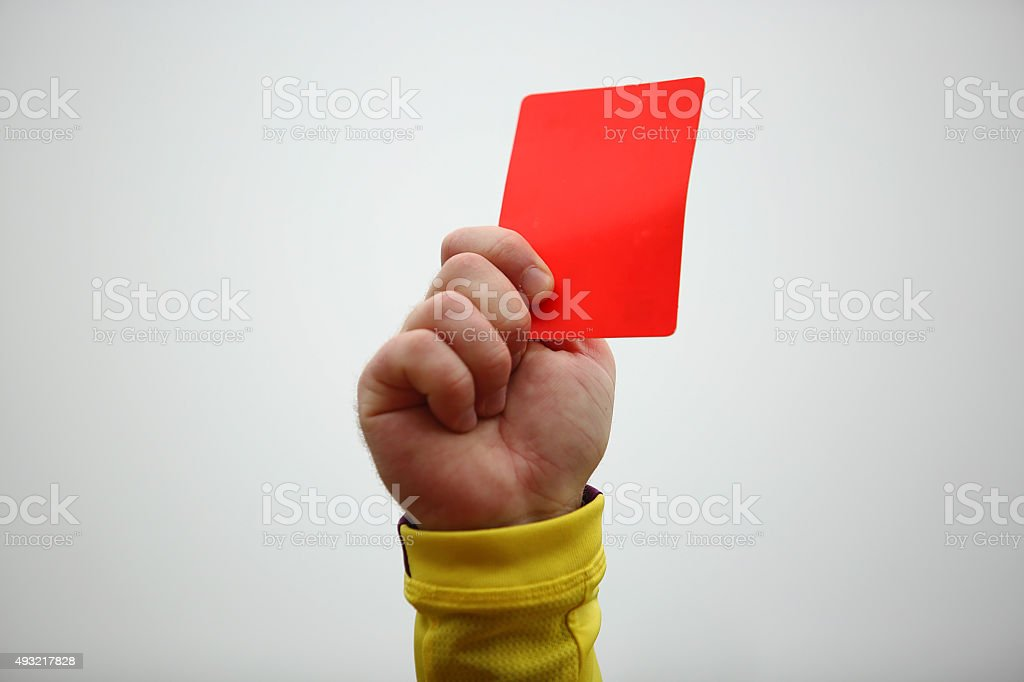 Hand holding up red card stock photo