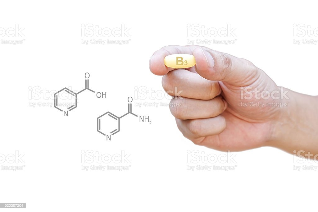 Hand holding vitamin B3 pill with clipping path stock photo