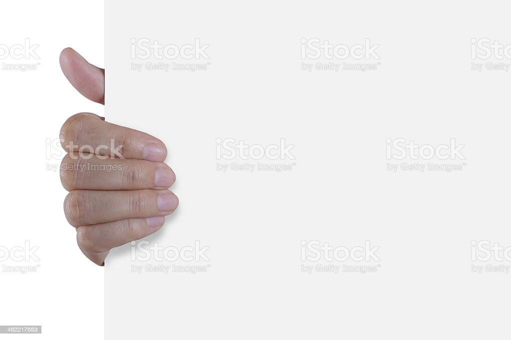 Hand holding white empty paper royalty-free stock photo