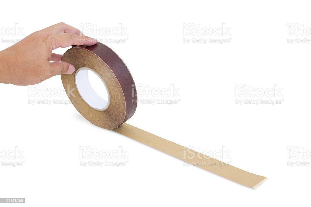 Mano che tiene il nastro in legno isolato con clipping path foto stock royalty-free