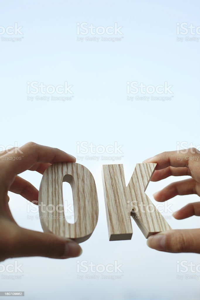 Hand Holding Wooden Letter - OK royalty-free stock photo