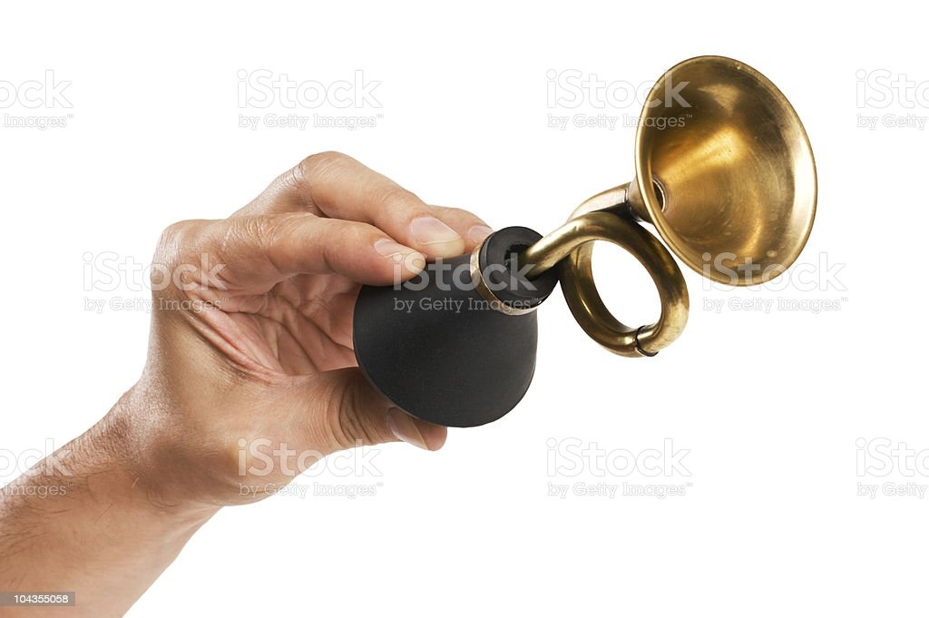 hand holds an old car horn stock photo