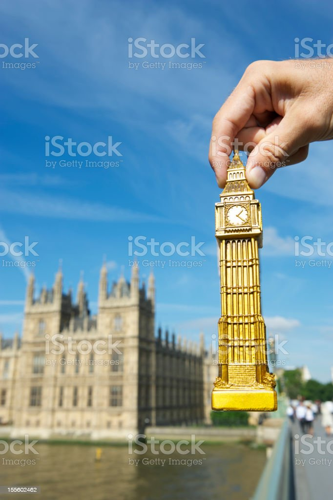 Hand Holds Big Ben Souvenir by Houses of Parliament stock photo