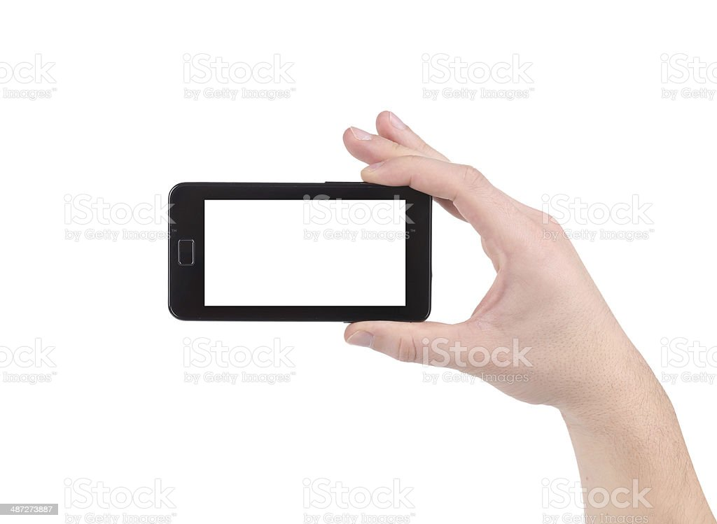 Hand holds cell phone with clipping path. stock photo