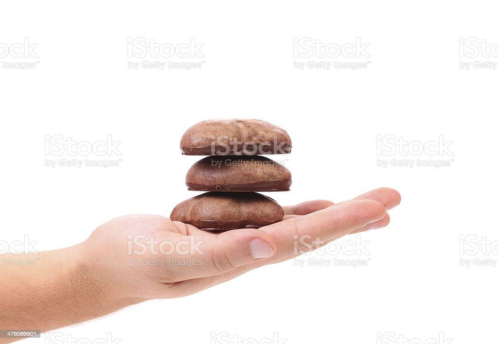 Hand holds chocolate meringues. stock photo